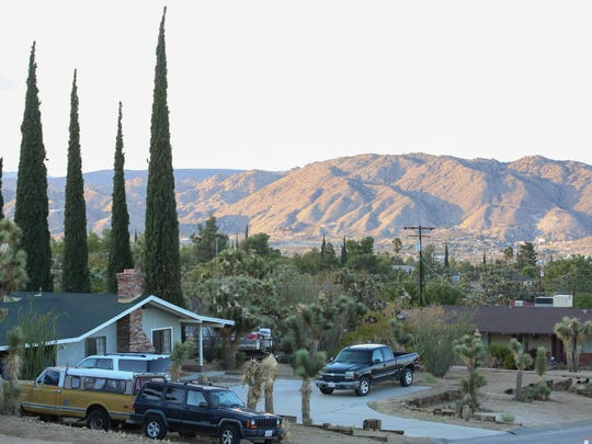 A typical home on a hillside in Yucca Valley with views of the surrounding mountains, September 28, 2016