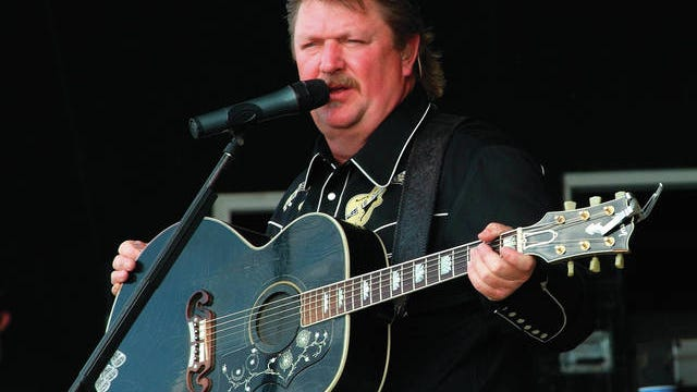 29 March 2020 GRAMMYÆ-winning country music legend Joe Diffie passed away today from complications of coronavirus (COVID-19). Diffie recently celebrated a career milestone of more than 25 years as a member of the historic Grand Ole Opry. File Photo: 19 July 2009 - Morristown, OH - Country music star JOE DIFFIE performs as a part of day four of Jamboree In The Hills 2009 with some lucky fans that he picked out of the crowd. Jamboree In The Hills 2009, referred to as the Superbowl of Country Music, is a four day Country Music Festival established in 1977 with over 100,000 people in attendance. Photo Credit: Jason L. Nelson/AdMedia /MediaPunch /IPX