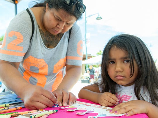 Michael Lopez, 4, colors with her aunt, Genny Valenzuela, both of Las Cruces on Saturday July 29, 2017 during the Kids EXPO 2017 at the Plaza de Las Cruces.