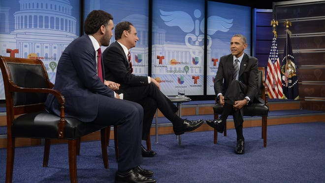 President Obama participates in a town hall event on affordable health insurance with moderator Jose Diaz Balart, center, and television host Enrique Acevedo at the Newseum on March 6 in Washington.