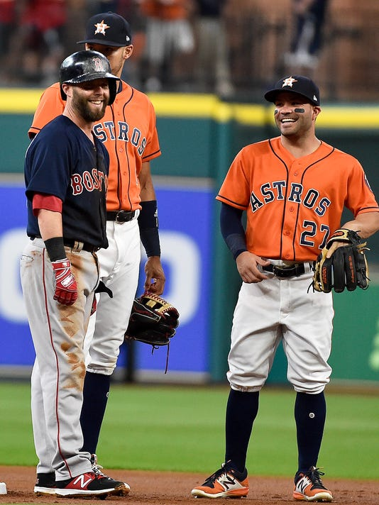 Boston Red Sox's Dustin Pedroia, left, jokes with Houston Astros second baseman Jose Altuve (27) while awaiting an umpire review of Pedroia's stolen base during the first inning of a baseball game, Friday, June 16, 2017, in Houston. (AP Photo/Eric Christian Smith)