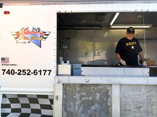 John Harper prepares a Philly steak and cheese and Philly chicken at Pucky's Pit Stop. Harper's food truck will be at Zane's Landing on October 15 for the food truck rally.