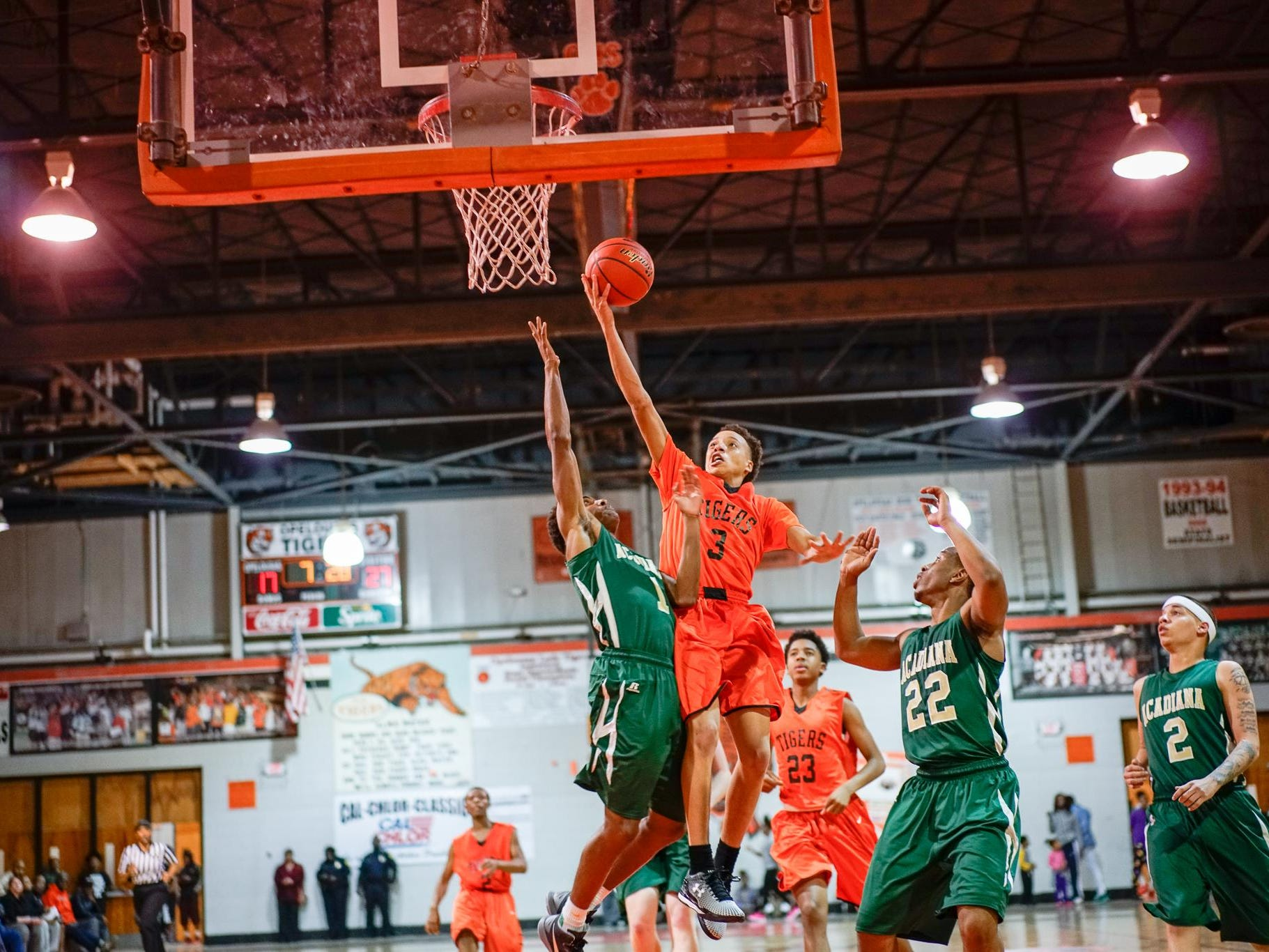 Opelousas High is shown in a recent game against Acadiana High. The Tigers' press was too much for North Central to handle Tuesday, as OHS won 65-50.