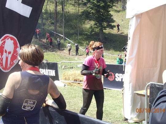 Ryndee Hamilton returned to participating in marathons and Spartan races after completing treatment for breast cancer.