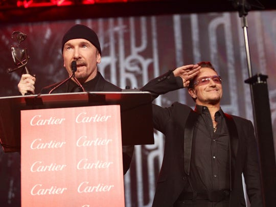 The Edge (left) and Bono of U2 accept the Sonny Bono Visionary Award during the Palm Springs International Film Festival Gala on Jan. 4.