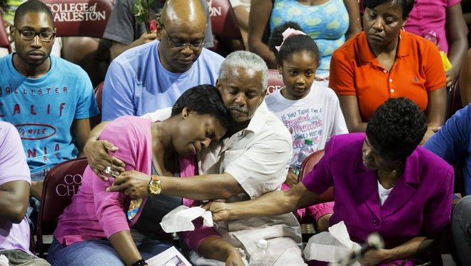 Families of the victims of a shooting at Emanuel AME Church in Charleston, S.C., comfort one another during a memorial service on June 19, 2015.
