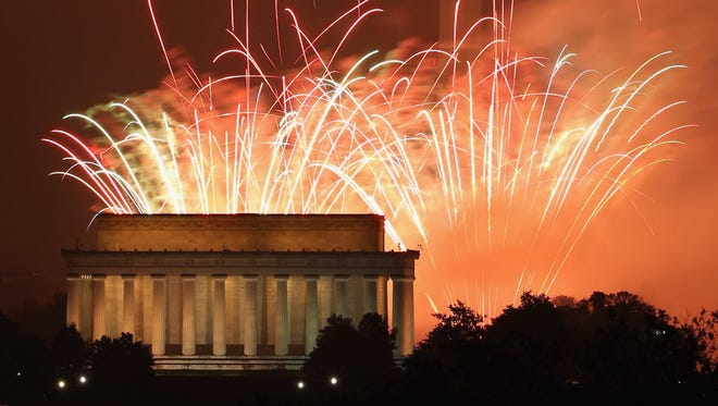 Fireworks explode over the National Mall on July 4, 2015.