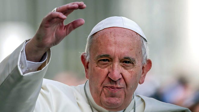 Pope Francis waves as he arrives for the General Audience in Saint Peters Square, Vatican City, Rome, on April 6.