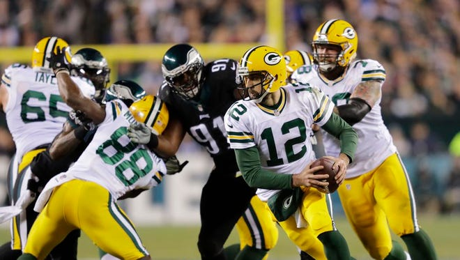 Green Bay Packers quarterback Aaron Rodgers scrambles under pressure in the first half.  The Green Bay Packers play against the Philadelphia Eagles Monday, November 28, 2016, at Lincoln Financial Field.