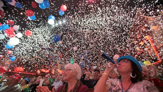Balloons and confetti drop onto the audience at the end of a New Year's Eve show in Palm Springs.