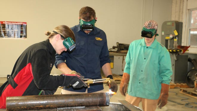 From left, Sussex County Community College student Erin Primavera, R.S. Phillips Steel owner Scott Phillips and student Sean McIntyre work in the McGuire Technical Education Center on Main Street in Newton. SCCC has received numerous community donations allowing students in programs at the center to gain hands-on experience.