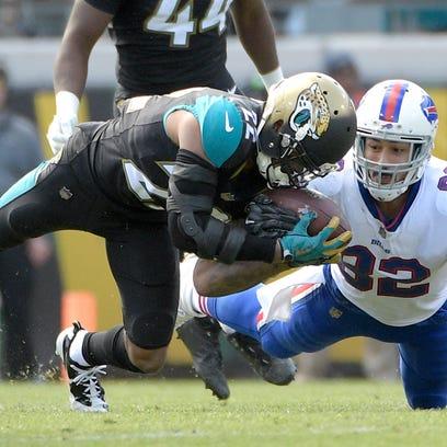 Jacksonville Jaguars cornerback Aaron Colvin (22) intercepts