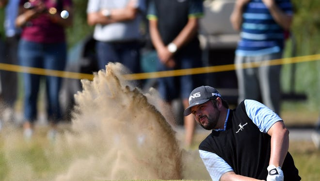 Kent Bulle plays from a bunker on the first hole during a practice round on Tuesday.