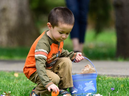 Silas Falter collects eggs at the Hayes Presidential Library and Museums at Spiegel Grove on Tuesday afternoon. Ohio Open Doors events at the Rutherford B. Hayes Presidential Library and Museums will include a tour of the 25-acre Spiegel Grove.