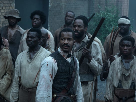 Nat Turner (center, Nate Parker) leads a slave revolt