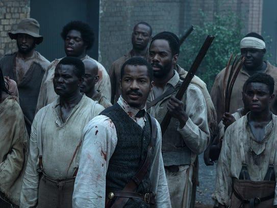 Nat Turner (center, Nate Parker) leads a slave revolt