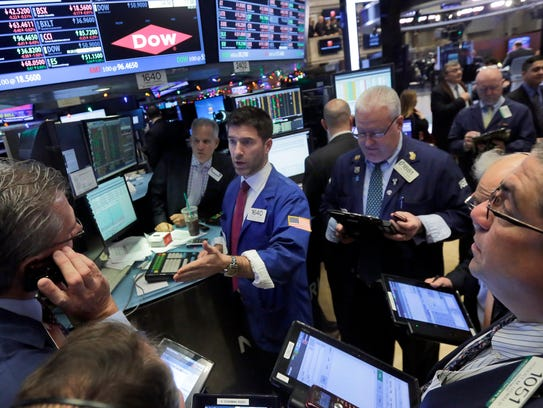 Traders gather at the post that handles Dow Chemical