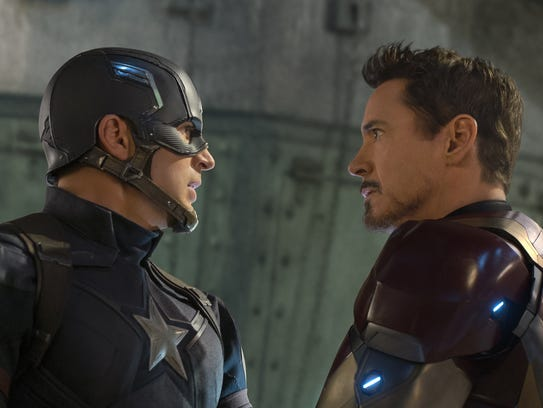 Chris Evans as Captain America and Robert Downey Jr.