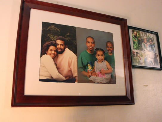Family photos hang on the wall of the Valentines' home