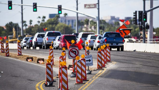 Traffic is stopped in the northbound lanes of Grand Avenue, at Bell Road in Surprise, Friday, April 1, 2016. Construction signs mark the Bell Road-US 60 Grand Avenue overpass construction that will close Bell Road for a half mile for 6-8 months.