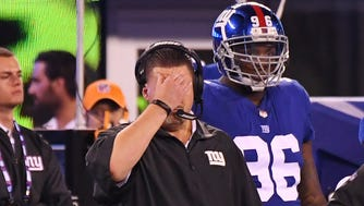 New York Giants head coach Ben McAdoo reacts to a play late in the 4th quarter against the Detroit Lions during a NFL football game at MetLife Stadium.