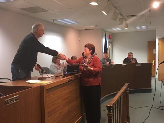 Butler Mayor Robert Alviene gives a plaque to outgoing Butler Museum Chairwoman Peggy Spranzani. Spranzani has been with museum for 19 years.