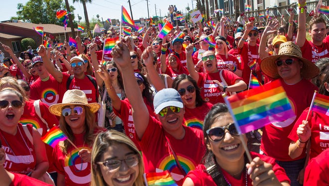 Target marchers cheer during the Phoenix Pride Festival Parade April 2, 2017.