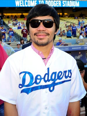 Manny Pacquiao prepares to throughout the first pitch on Monday.