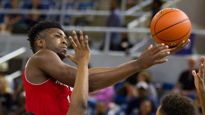 North Caddo's  Cherrod Hill shoots against Madison Prep during their play-off game in the LHSAA Boy's Top 28 Semi-Finals in Lake Charles March 10, 2016.