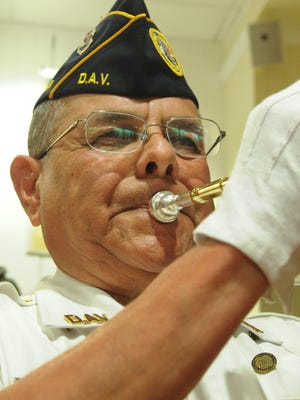 Disabled American Veterans Cmdr. John Calderon plays taps during an earlier event at the Museum of Military History in Simi Valley. The 77th anniversary of the bombing of Pearl Harbor and America's entry into World War II will be commemorated at the museum on Friday.