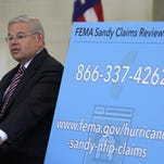 U.S. Sen. Robert Menendez speaks to Sandy victims considering having their flood insurance claims reviewed during a National Flood Insurance Program Claims Review Clinic at Civic Plaza in Brick on June 15. FEMA announced Thursday that policyholders would have until Sept. 15 to begin the process.