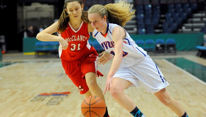 Livonia's Molly Stewart drives against a Monsignor McClancy-Queens defender in the Class B Federation Championships in Albany.