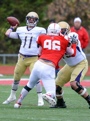 Albion quarterback Dominic Bona drops back to pass against Olivet on Oct. 31.