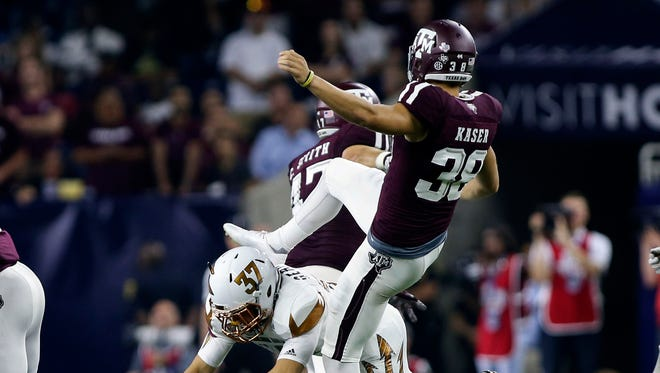 Sep 5, 2015: Arizona State Sun Devils safety Coltin Gerhart (37) runs into Texas A&M Aggies punter Drew Kaser (38) during the third quarter at NRG Stadium. The Aggies defeated the Sun Devils 38-17.