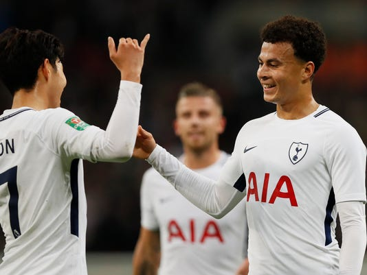 Tottenham's Dele Alli, right, celebrates with teammate Son Heung-min after he scored his side's second goal during the English League Cup soccer match between Tottenham Hotspur and West Ham at Wembley stadium in London, Wednesday, Oct. 25, 2017. (AP Photo/Kirsty Wigglesworth)