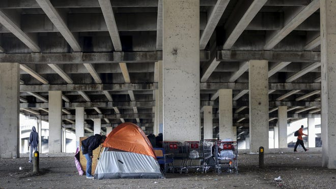 Tents inhabited by people who are homeless can be seen scattered under I-35 in Austin on January 10.