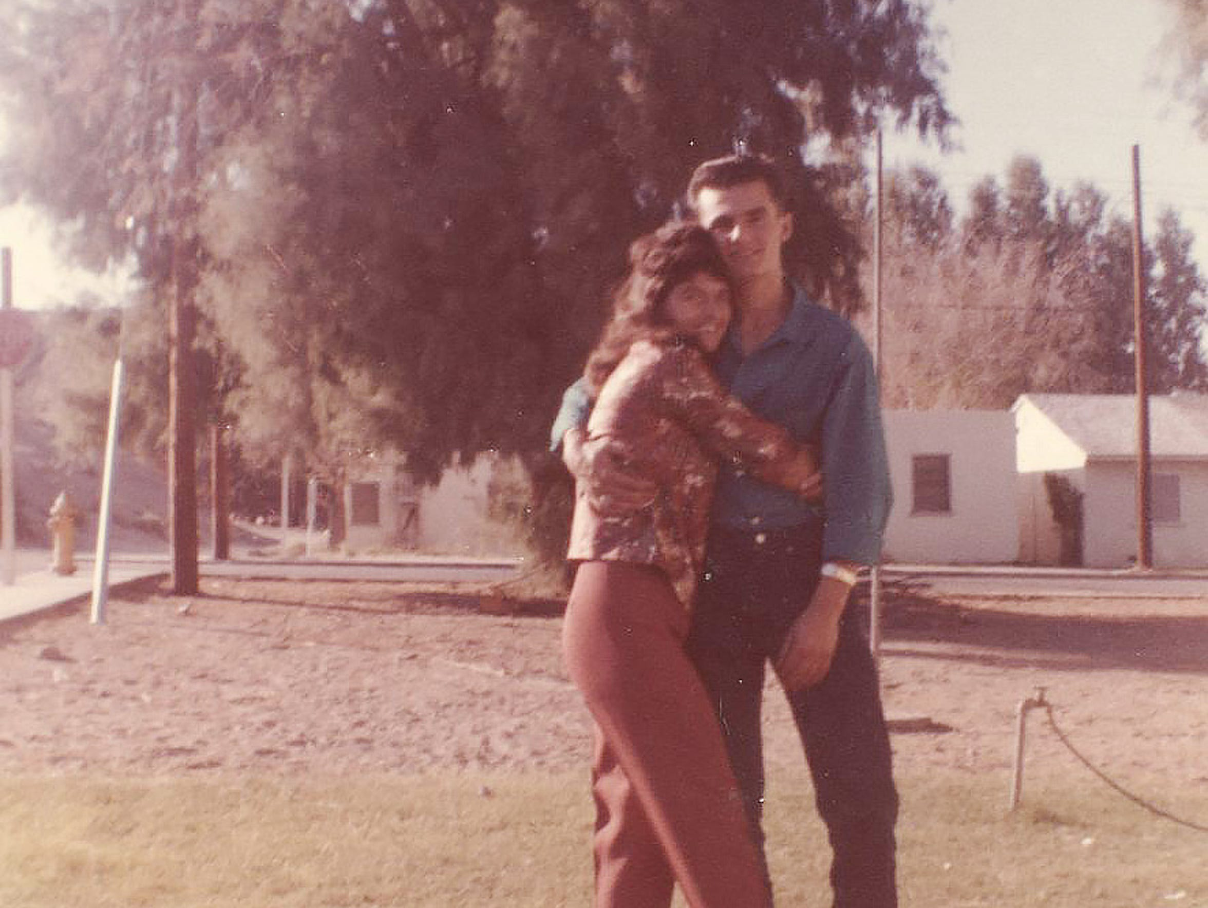 Bob Paillet is embraced by a sister.
