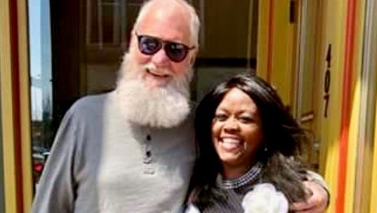 Dave Letterman poses for a photograph with Congressional candidate Jeannine Lee Lake after they ran into each other at a downtown Muncie coffee shop.