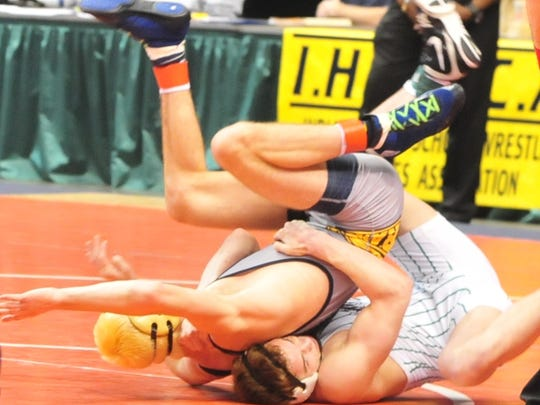 Yorktown's Brad Laughlin wrestles in the quarterfinal round of state competition on Saturday. Laughlin went on to win a state championship later that night.