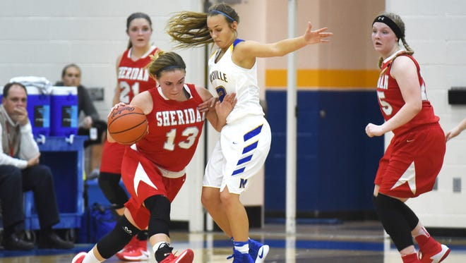 Sheridan's Jayden Geary drives past Maysville's Olivia Shirley Wednesday night. Sheridan went on to win 57-40.