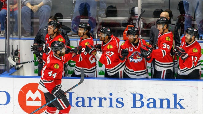 Cody Franson is congratulated by the IceHogs' bench after he scored a goal during the team's 2018 playoff run. The Hogs made it to the AHL's Western Conference Finals that year, and they re-signed Franson on Wednesday.