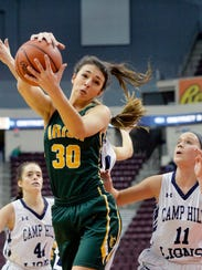 York Catholic's Emily Laslo gets the rebound against