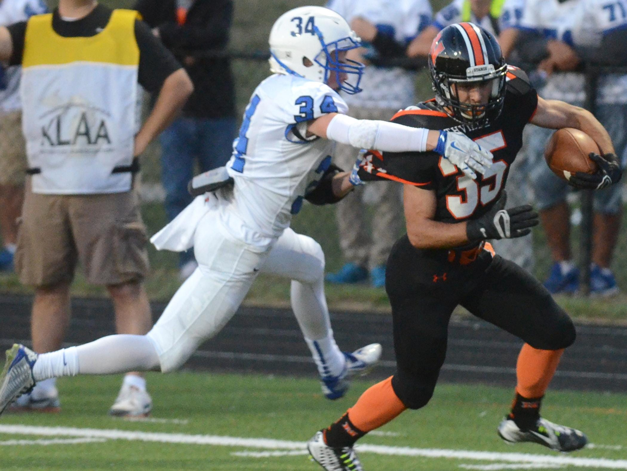 Northville's Adam Ghabra (right) runs the ball against Salem's Jacob Miller.