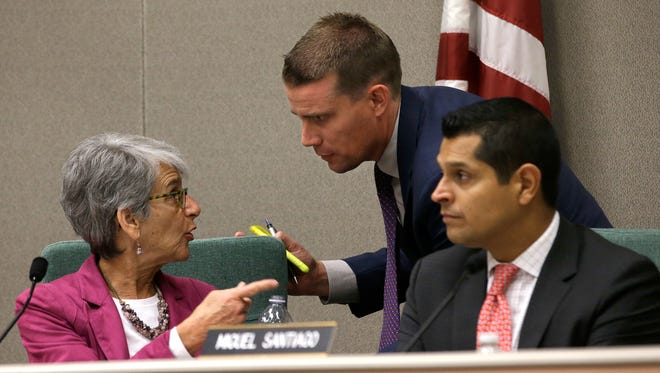 State Sen. Mark McGuire, D-Healdsburg, center, huddles with Sen. Hannah-Beth Jackson, D-Santa Barbara and Assemblyman Miguel Santiago, D-Los Angles, during a hearing looking into the failures of emergency warning systems in October's wildfires on Monday in Sacramento.