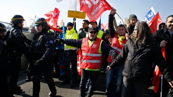 Air France employees demonstrate amid a strike over