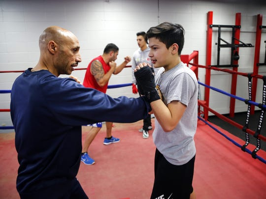 Des Moines Senior Police Officer John Saunders works with Mario Rodriguez, 14, at the Des Moines Police Boxing Club on Thursday, Jan. 26, 2017.