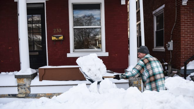 Andy Angelucci of Annville shovels his sidewalk along Rt. 422 in Annville as people continued to dig out from snowstorm Jonas on Monday, Jan. 25, 2016. The snowstorm slammed Pennsylvania Friday, Jan. 22 and Saturday, Jan. 23 dropping close to 29 in. of snow on Lebanon County.