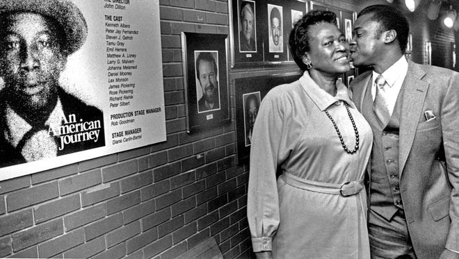 """Sylvia Bell White got a kiss from her son Douglas in 1987 after watching """"An American Journey,"""" a play about her family.  White's brother Daniel Bell was killed by a Milwaukee officer in 1958."""