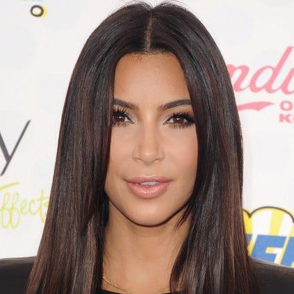 LOS ANGELES, CA - AUGUST 10:  Kim Kardashian arrives at the 2014 Teen Choice Awards at The Shrine Auditorium on August 10, 2014 in Los Angeles, California.  (Photo by Jon Kopaloff/FilmMagic)