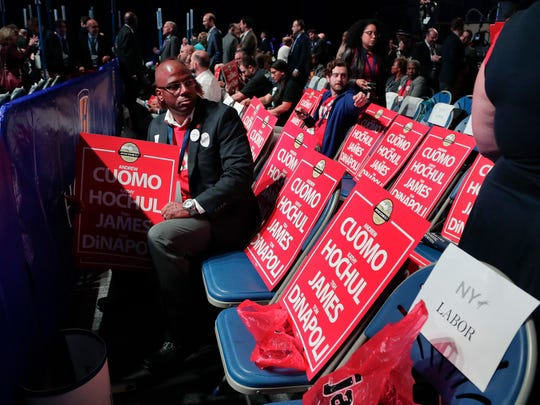 A member of the Retail, Wholesale and Department Store Union waits for the start of the New York state Democratic convention, Wednesday, May 23, 2018, in Hempstead, N.Y.